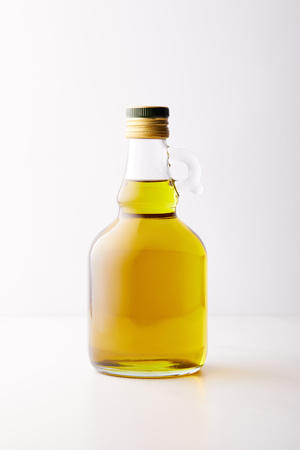 bottle of extra virgin olive oil isolated on grey background Stock Photo