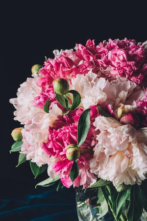 bouquet of beautiful pink peonies on dark background Imagens