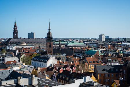 cityscape of Copenhagen with spire of City Hall, Denmark