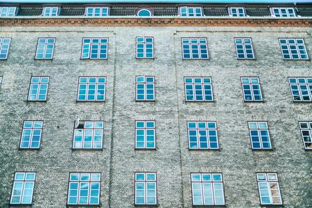 low angle view of building with arranged windows, copenhagen, denmark Фото со стока