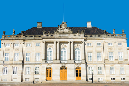 beautiful architecture of historical Amalienborg castle with columns and statues in copenhagen, denmark Editorial