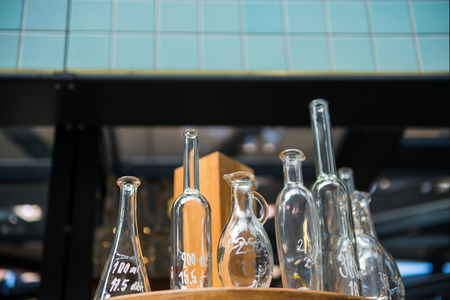 low angle view of glass bottles on blurred background