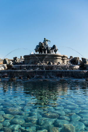 low angle view of famous Gefion Fountain against blue sky in copenhagen, denmark