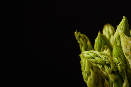 close-up shot of fresh asparagus bunch isolated on black
