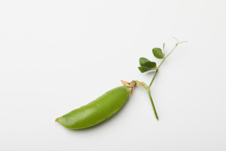 top view of green pea pod on white surface Stock Photo