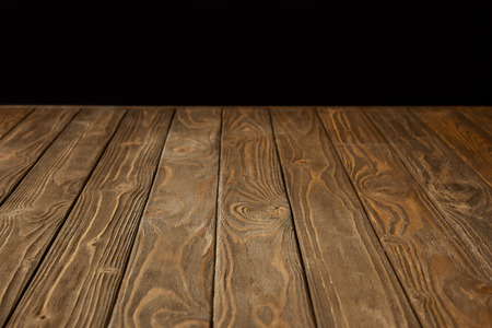 empty wooden tabletop isolated on black