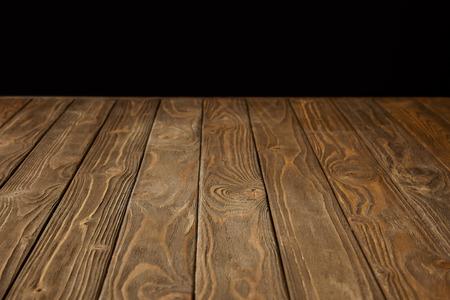 empty wooden tabletop isolated on black Reklamní fotografie - 106017438