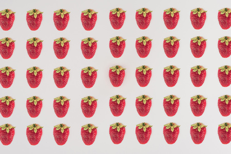 Rows of strawberry isolated on white background Stock Photo
