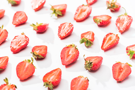 red fresh cut strawberries on white background Stock Photo
