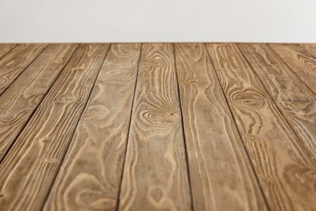 empty wooden tabletop isolated on grey