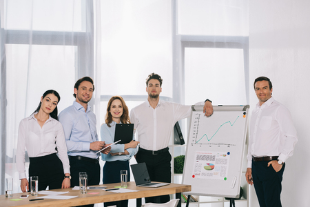 portrait of business people after business training standing at white board in office Stock Photo