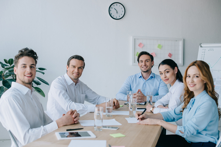 portrait of smiling business colleagues at workplace in office