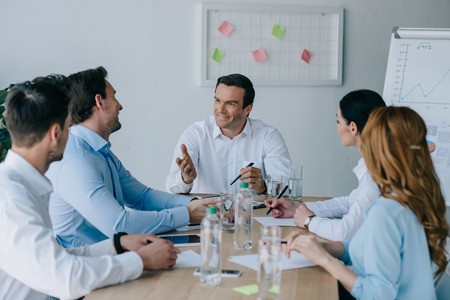 business colleagues having discussion at workplace in office
