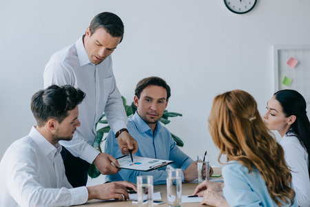 business coworkers having business training at workplace in office Stock Photo