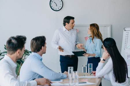 group of business coworkers having business training in office