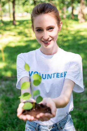 attractive smiling volunteer holding new in hands
