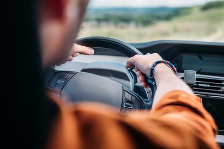 cropped image of man sitting behind his car wheel Stock Photo
