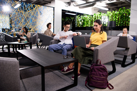 group of multicultural businesspeople working at modern coworking office