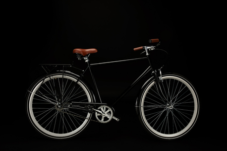 side view of classic vintage bicycle isolated on black Stock Photo