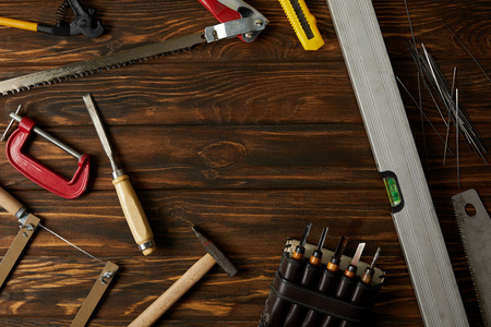 elevated view of different tools on brown wooden tabletop Stock Photo
