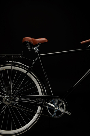 wheel, saddle and pedals of classic bicycle isolated on black Banco de Imagens