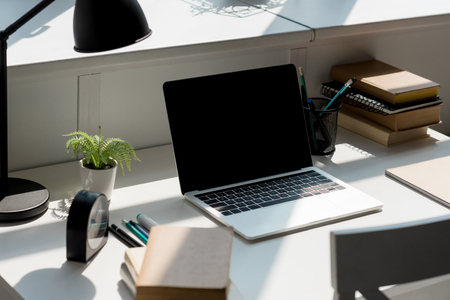 close-up shot of modern workplace with laptop at home 版權商用圖片