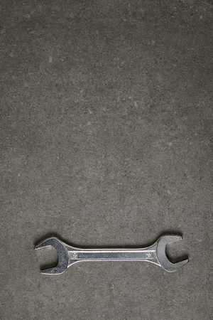 elevated view of spanner on gray surface