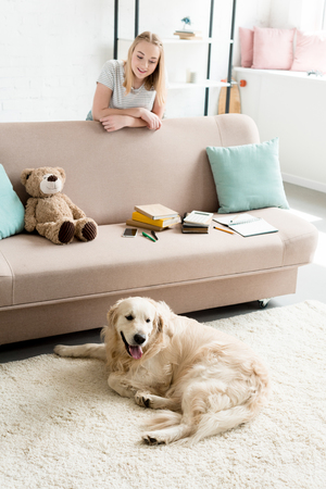 happy teen girl spending time at home with her dog Banque d'images - 106069912