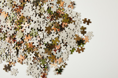 top view of jigsaw puzzle pieces with copy space on grey Foto de archivo
