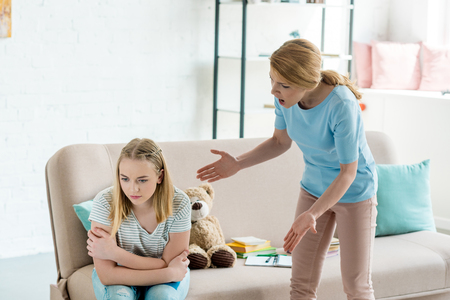 angry mother yelling at teen daughter at home Foto de archivo