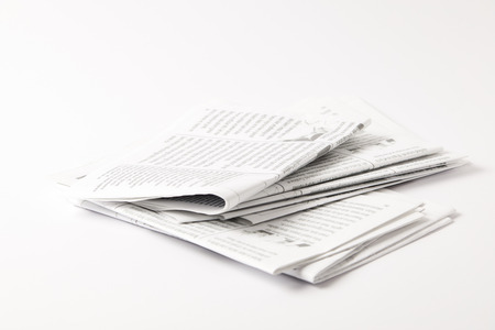 heap of black and white newspapers, isolated on white 스톡 콘텐츠