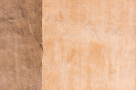 empty light brown concrete wall textured background