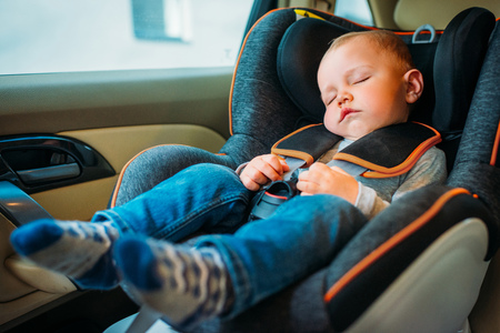 cute little baby sleeping in child safety seat in car 스톡 콘텐츠