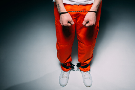Cropped view of man wearing orange pants in cuffs on dark background 스톡 콘텐츠 - 106118383