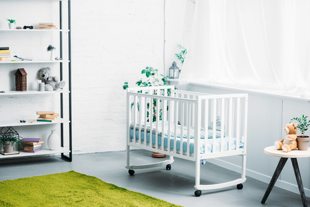 interior of modern light childrens room with crib Stockfoto
