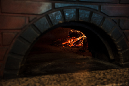 close up view of empty brick oven in restaurant