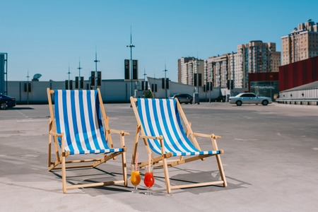 sun loungers with cocktail on parking on sunny day Stock Photo