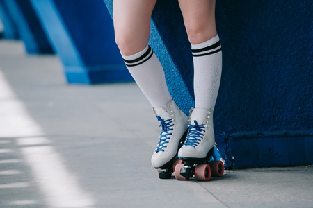 partial view of woman in white high socks and retro roller skates