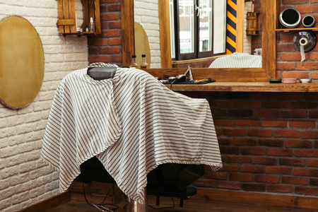 empty chair at modern barber shop interior