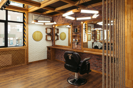 stylish interior in empty modern professional barber shop
