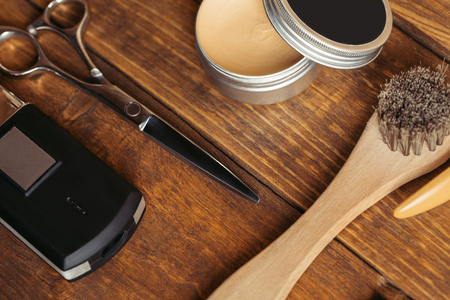 close-up view of professional barber tools on wooden surface Фото со стока