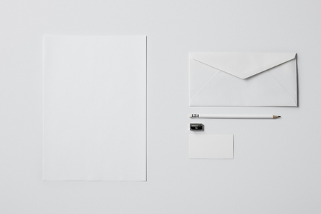 top view of business mockup with paper supplies and pencil on white surface for mockup Stok Fotoğraf