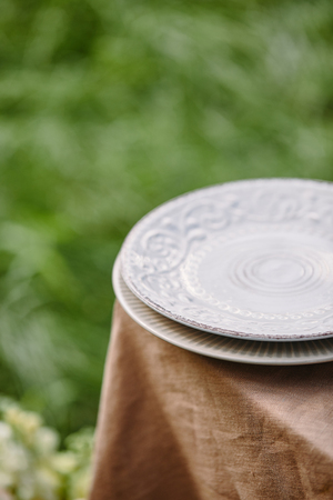 two plates on table in garden Stockfoto