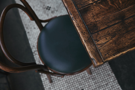 high angle view of vintage wooden table and chair standing at restaurant