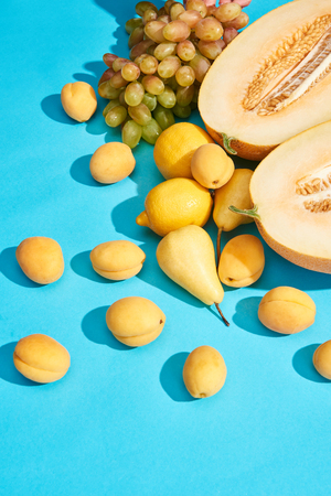 high angle view of sweet ripe tasty fruits on blue background