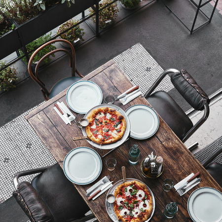 top view of different delicious pizza on trays at restaurant