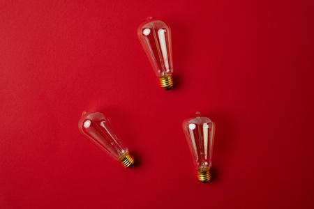 top view of vintage incandescent lamps on red tabletop
