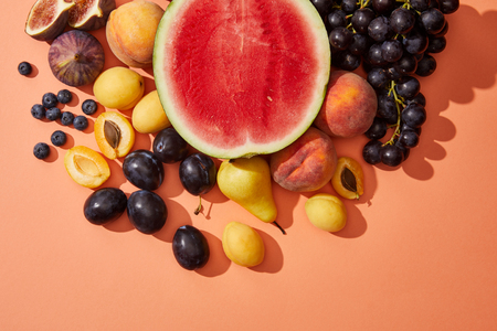top view of various fresh ripe sweet summer fruits on red Banque d'images