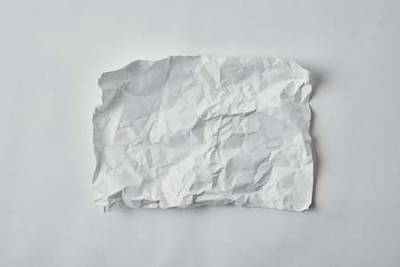 top view of blank crumpled paper on white surface