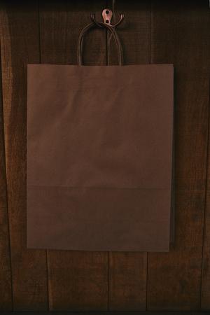 blank paper bag hanging on wooden wall Reklamní fotografie